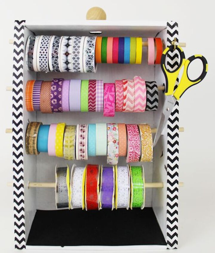 s 8 ways to turn cardboard boxes into beautiful storage for your home, Make a washi tape organizer dispensor