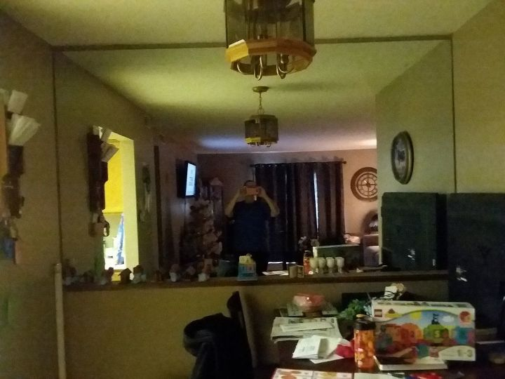 q what can i do with this large mirror with out taki g it down