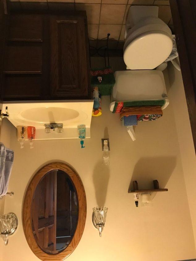 q how do i make this bathroom look bigger