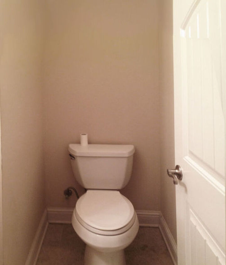 View of the toilet from doorway.