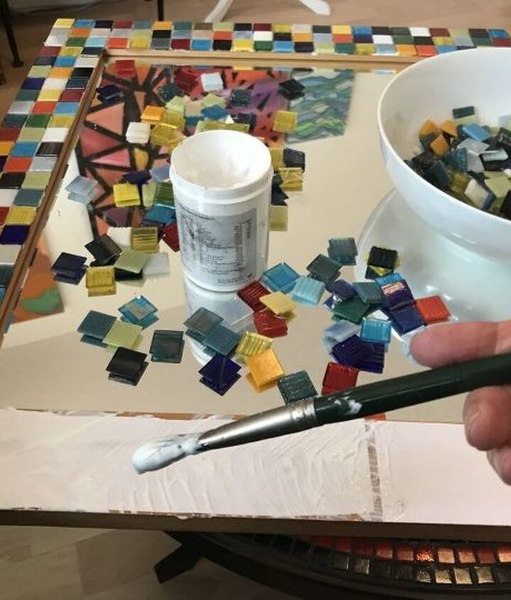 Position and glue mosaic tiles to frame