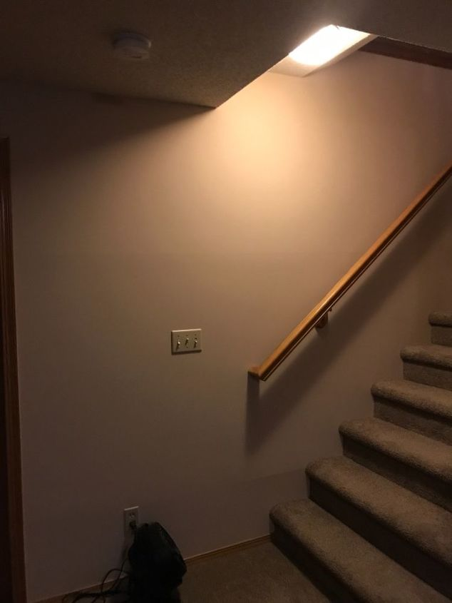 q how do i decorate in style an eye catcher a slanted staircase wall
