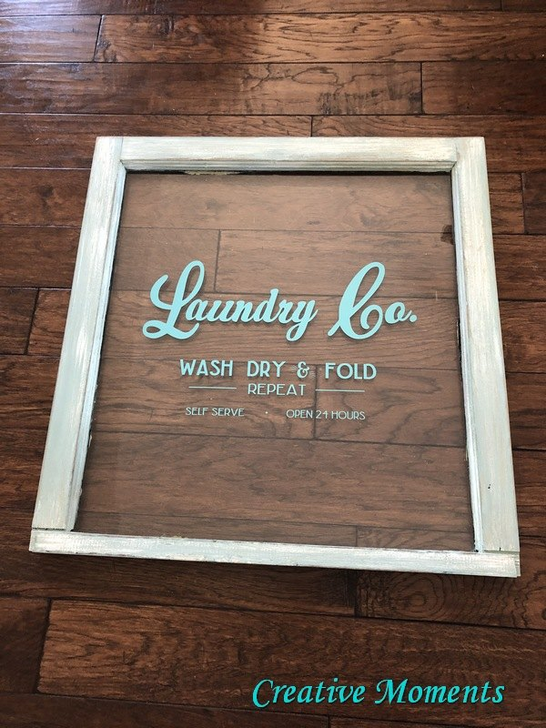 old window to new laundry room sign