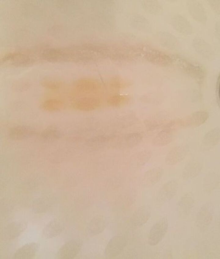 q how to remove stain from claw foot tub