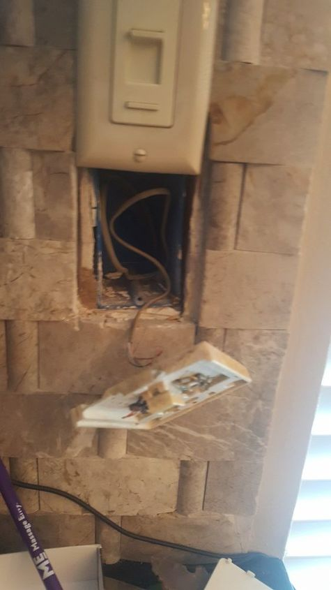 q cover up an old phone outlet where there is tile already in place