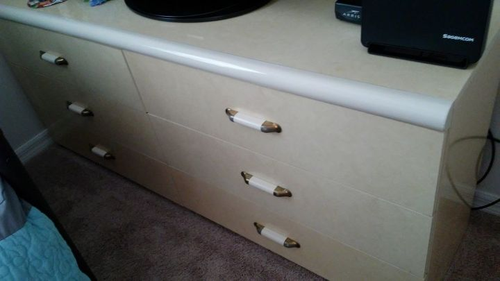q how to i fix this yellow italian formica dresser