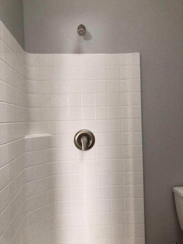 q how do i hang a shower curtain