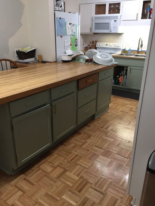 q how can we update this formica counter with wood trim ona budget