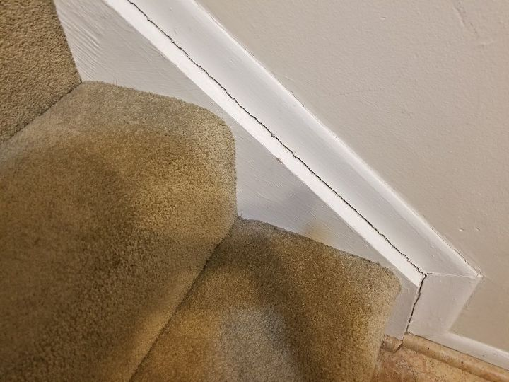 q how do i prevent cracks between my stair skirt and wall molding