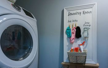 Adorable Laundry Room Storage From an Old Cabinet Door!