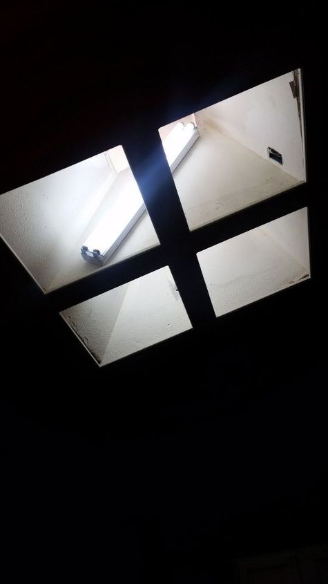 q any ideas on what to do with this kitchen skylight
