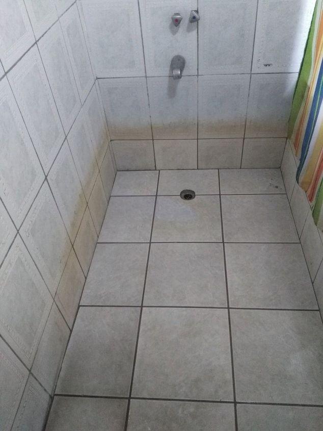 q how do i clean the 2 bottom rows of my bathroom wall tiles
