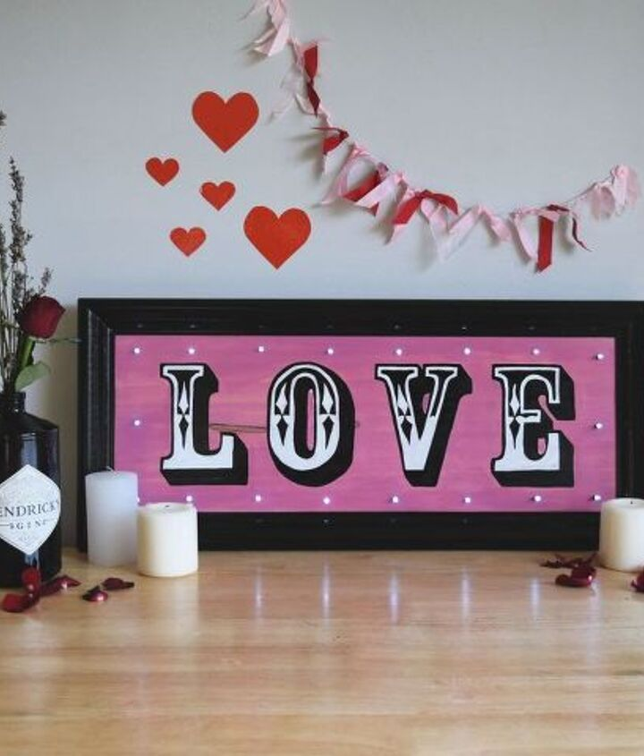 hand painted love sign with fairy lights perfect for valentine s day