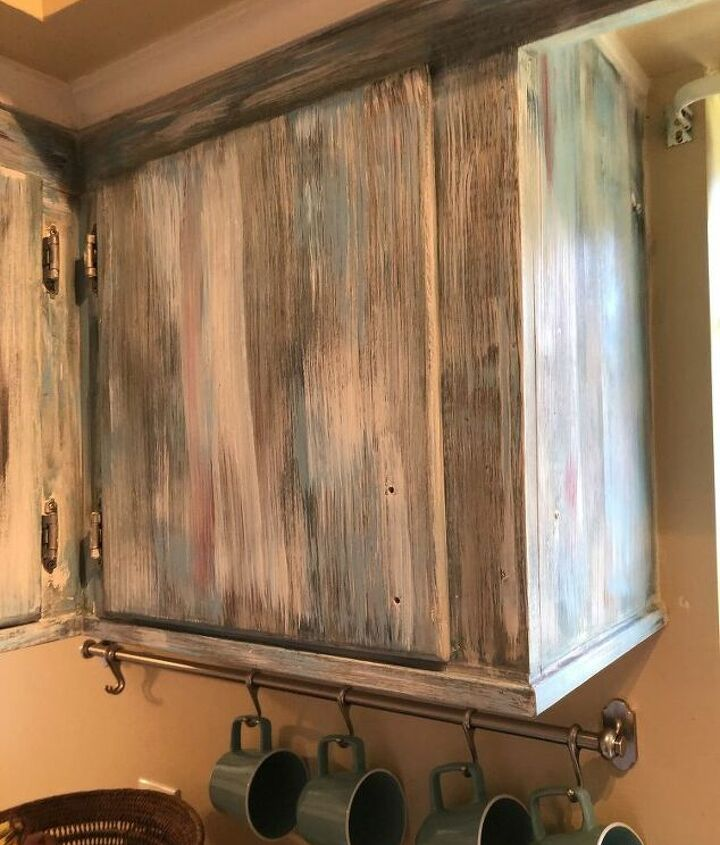 refreshing cabinets with a layers and layers of paint