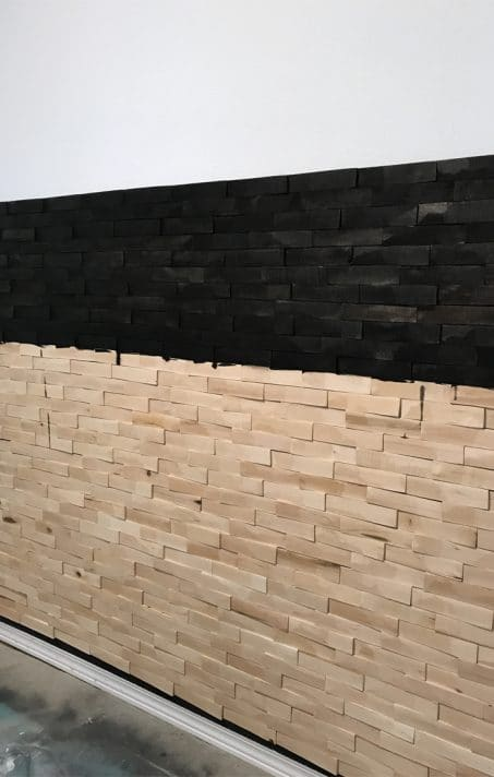 how to create a dramatic wall accent using wood shims