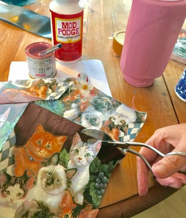 Cutting out cat from napkin