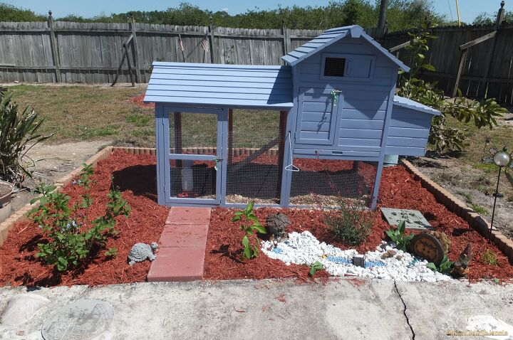 s 25 great ideas to improve your curb appeal in a weekend, Discover How to Quickly Landscape Even Your Garden s Chicken Coop