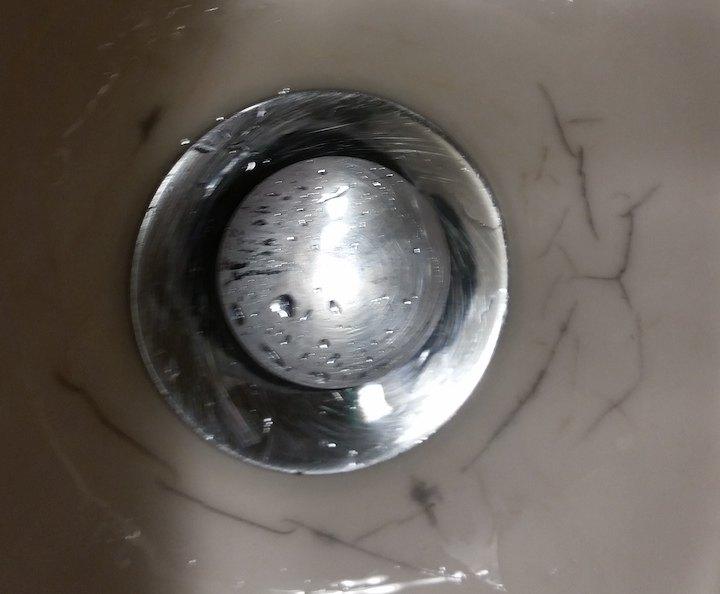 q how to fix black veining around drain hole of vanity sink