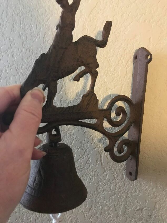 q hanging a cowboy bell