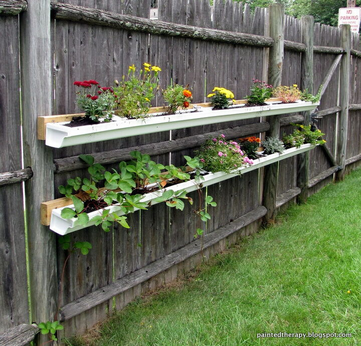 s 14 creative ways to plant a vertical garden maximize space, Repurpose Old Guttering for Herbs and Planters