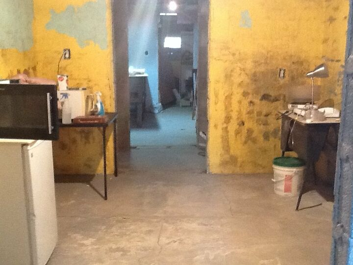 q how to remove dark spot from a brick wall in kitchen
