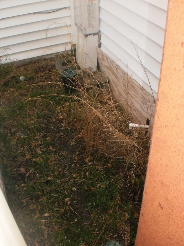 q how to use an l shaped hard to mow area tween house well house