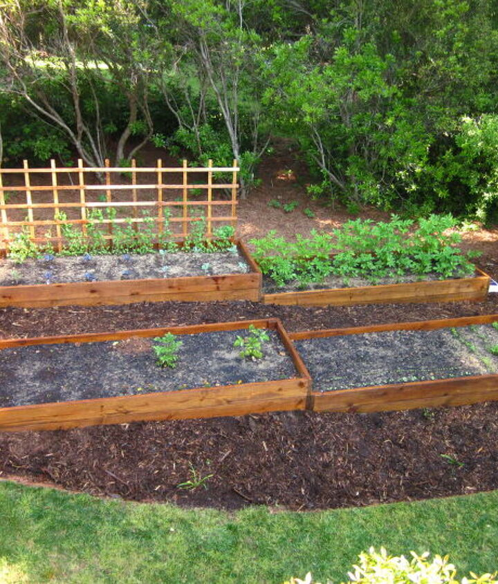 s diy raised garden bed ideas, Raised Beds For Sloping Gardens