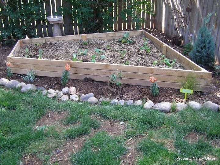 s diy raised garden bed ideas, The Answer To Odd Shaped Space In Your Garden