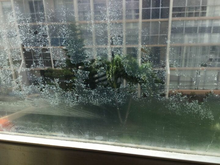 q how to take off glue residue from windows after taking off plastic
