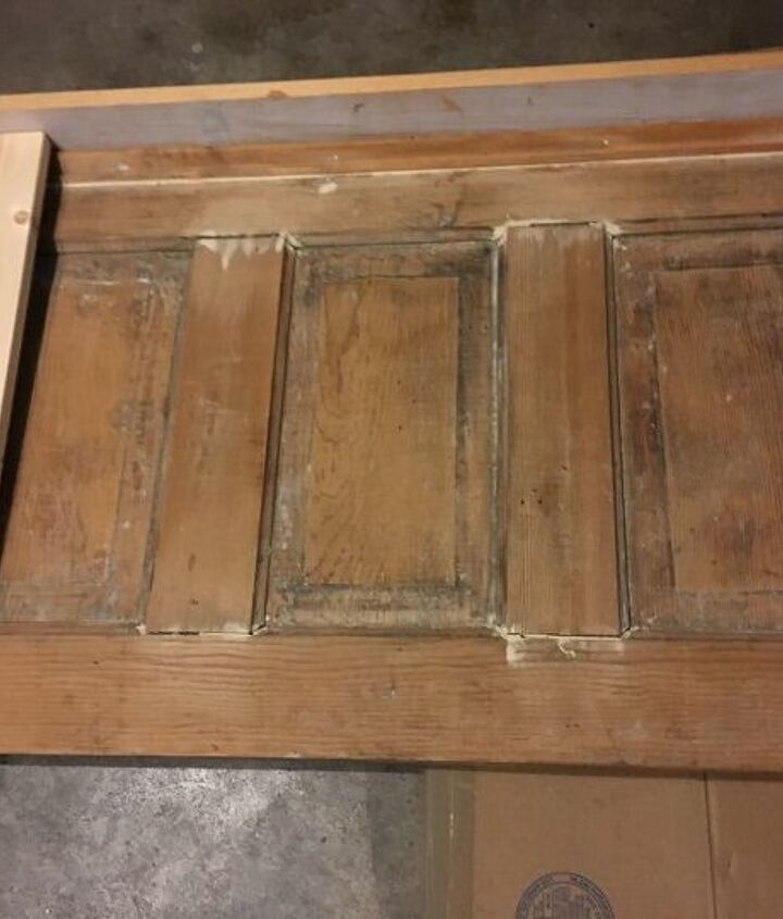 a reclaimed door becomes a farmhouse headboard