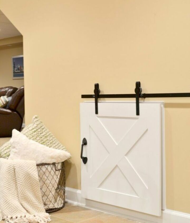 s 20 diy barn door ideas, DIY Barn Door to Conceal a Crawl Space