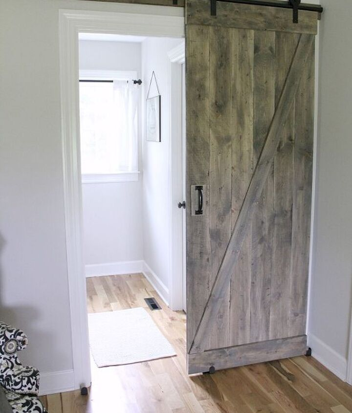 s 20 diy barn door ideas, A Sliding Barn Door for a Farmhouse Style Bedroom