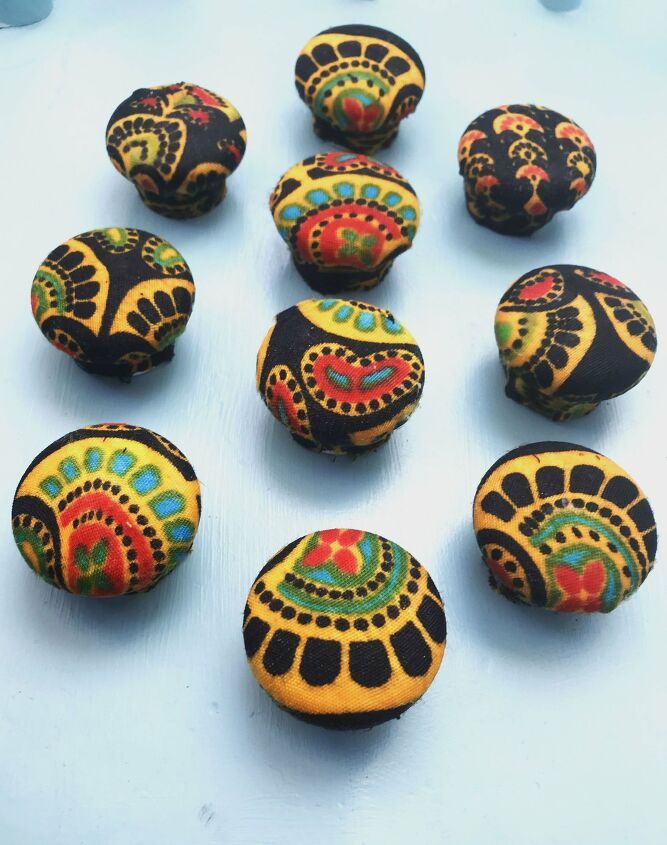 s use scrap fabric to update your furniture and your home, Give your drawer knobs a new look