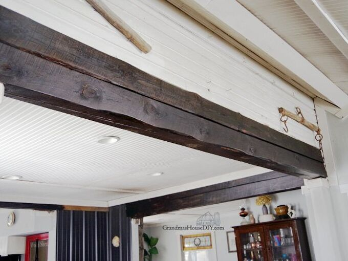 sanding down and refinishing the beams throughout my home