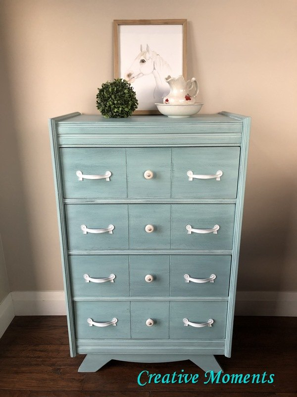 milk painted dresser in a water look