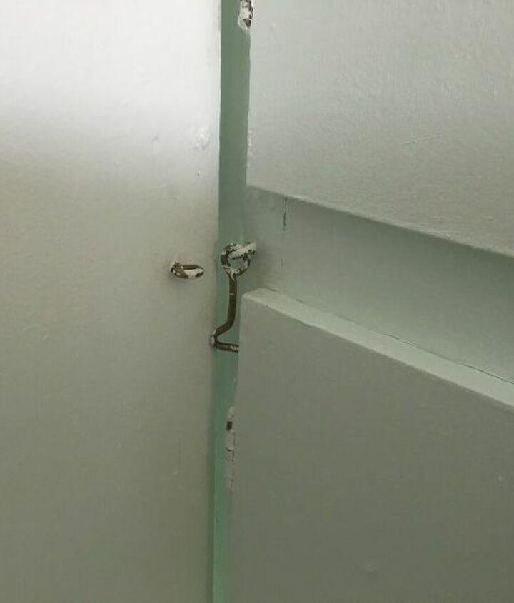 q how can i lock a pocket door
