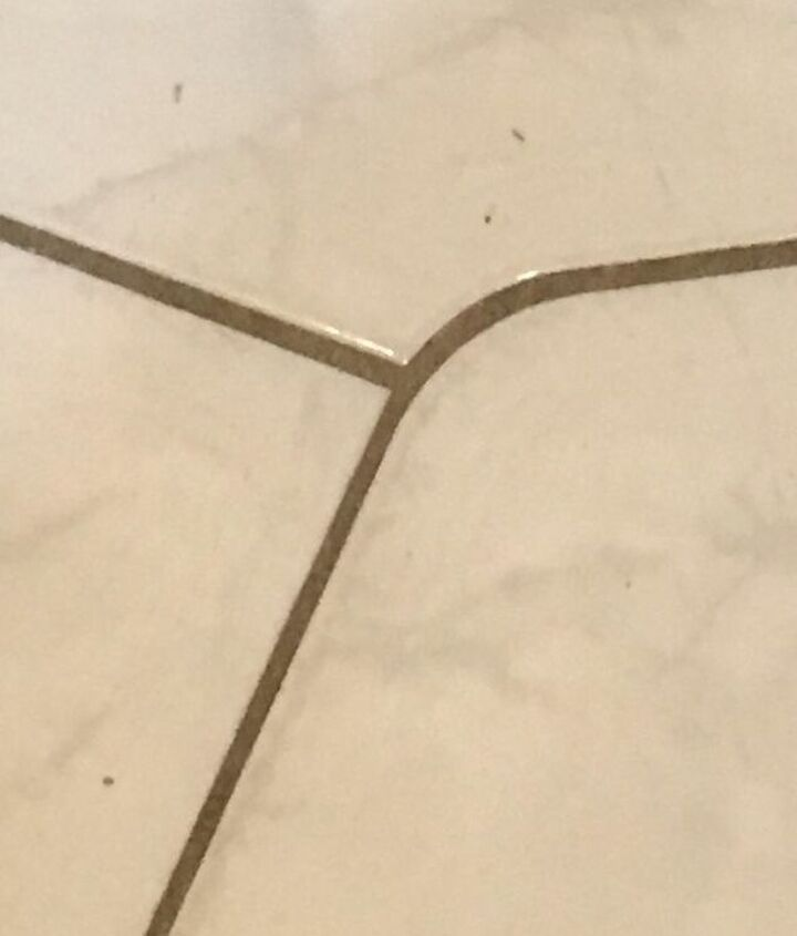 q how do i clean the grout in my tile floor