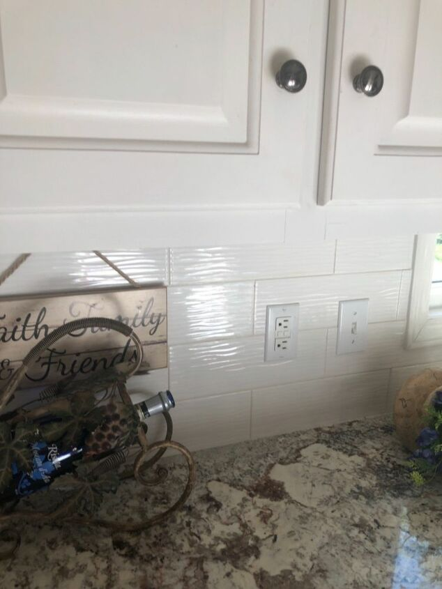 q we just installed granite which we love and backsplash cabinets are