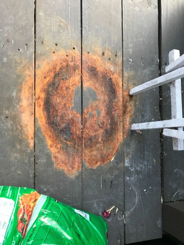 q remove a rust stain from a wooden deck
