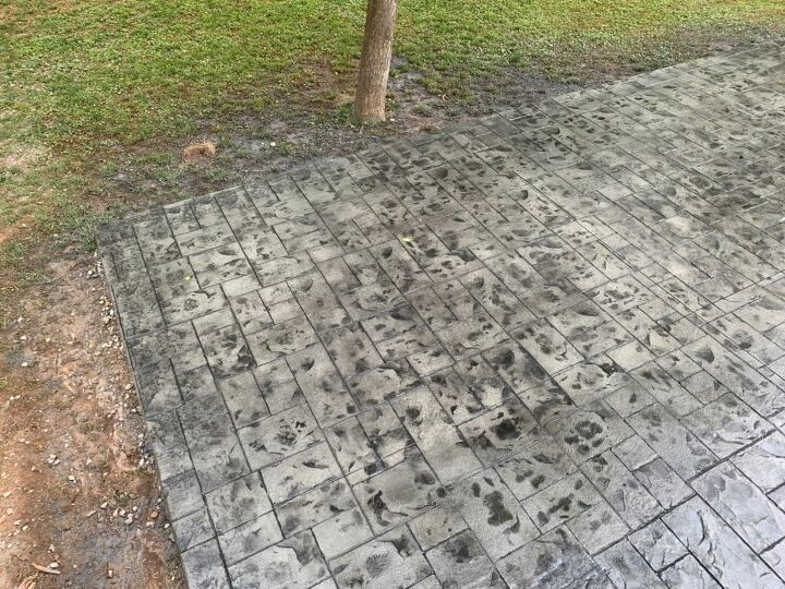 q correct black spots on stamped concrete