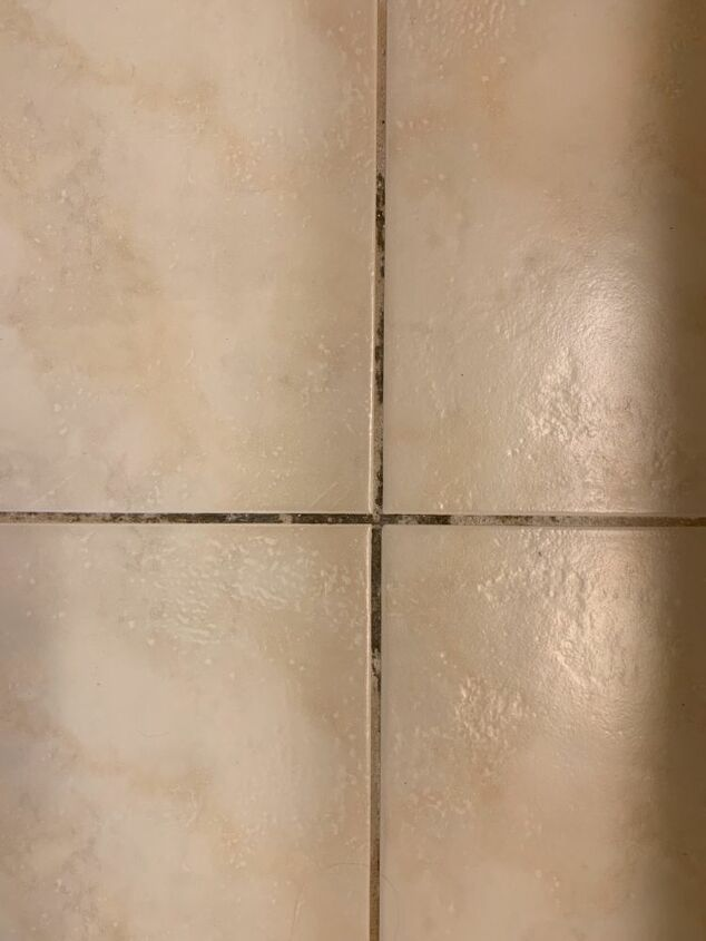 q cleaning dirty floor tile grout
