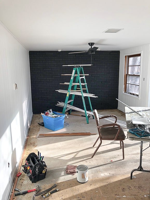 painted brick room makeover in our flip house