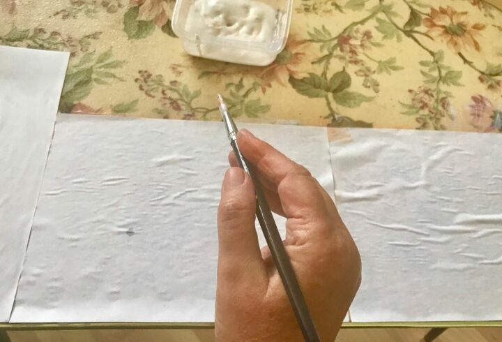 Glue paper to table top