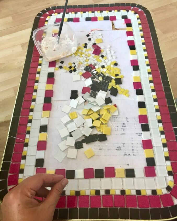 Laying the mosaic glass tiles