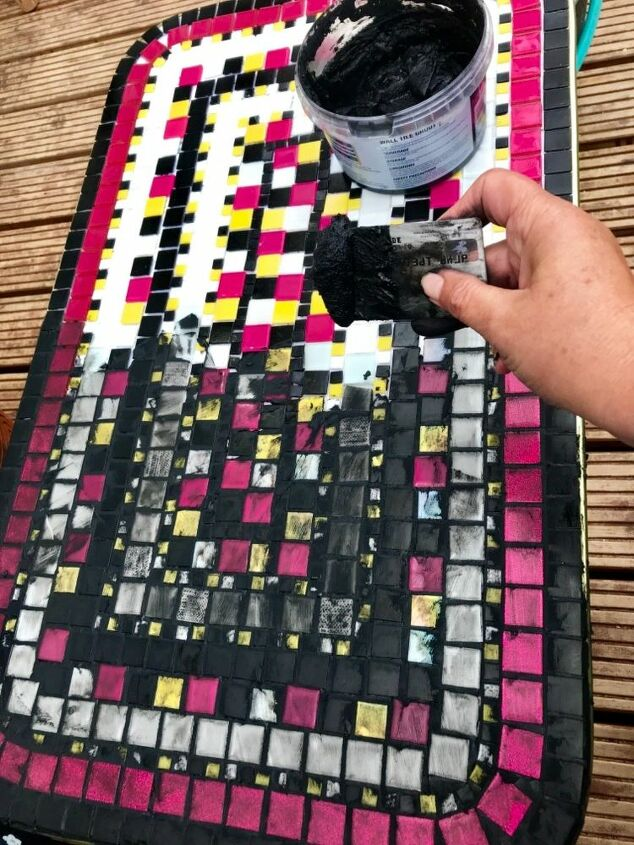 Use an old credit card to spread grout