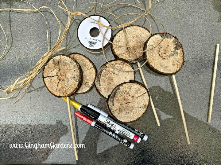 how to make cute garden signs or plant tags from a junk wood pile