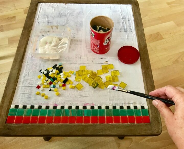 Use PVA glue to stick tiles onto table top
