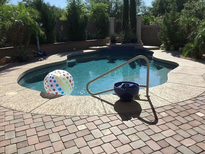 q misters around a pool