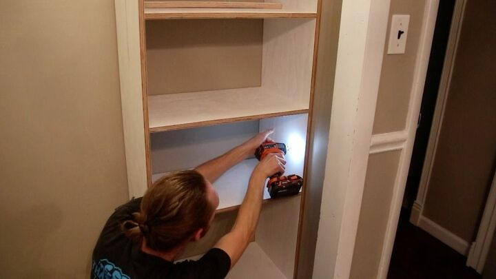 Attaching the shelf into the wall stud