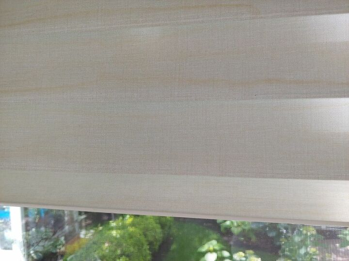 q how do i get rain stains off a cloth window shade